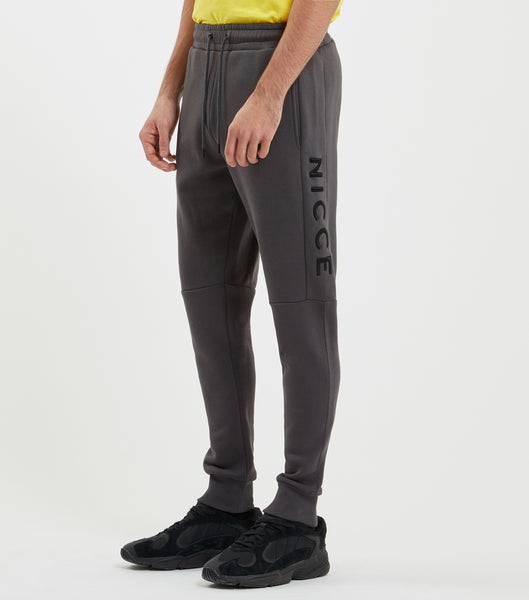 Mercury jogger in coal. Features skinny fit, thigh raised embroidery branding, two pockets, elasticated waist with drawcord and elasticated ankles. Pair with hood.
