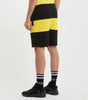 Masli jog shorts in black and yellow. Featuring colour block design, printed logo, zip pockets and elasticated waistband. Pair with hood.