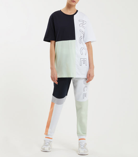 Limited edition cabana t-shirt in mint. Featuring crew neck, short sleeves, colour block design, printed Pair with joggers or denim.  This style is a unisex style, size down for a better fit for women.