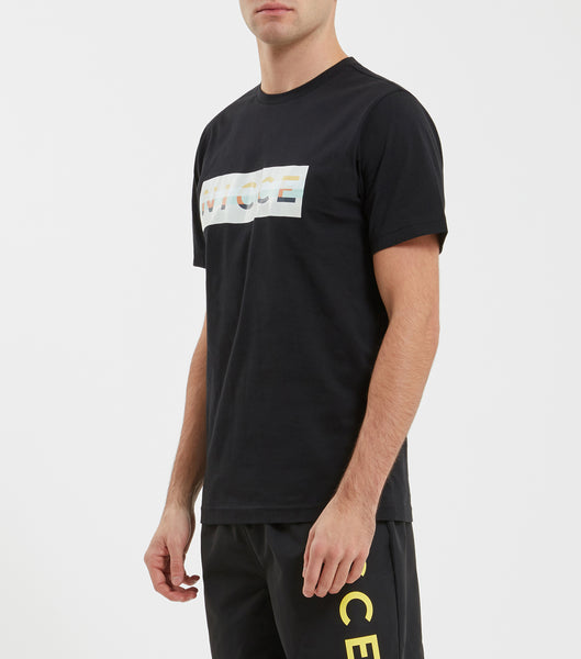 Hyam large logo t-shirt in black. Features 90s style embroidered box logo, short sleeves and regular fit. Pair with joggers or denim.