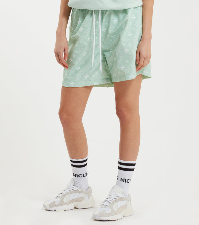Tarcola swim shorts in mint. Featuring repeated 'N' logo design, mesh lininer, pockets, elasticated waistband and pull cord. Pair with vest or t-shirt.  This is a unisex product, size down for true women's sizing.
