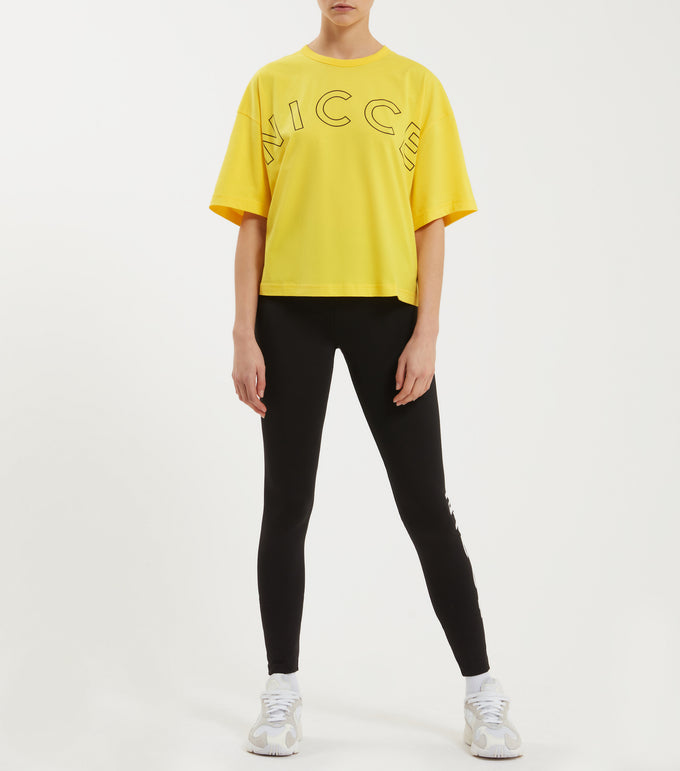 Ambush t-shirt in yellow. Featuring crew neck, over sized design, dropped shoulder, short sleeves, printed keyline logo. Pair with joggers or denim.