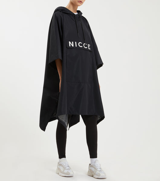 Poncho in black. Featuring classic poncho design, printed nicce logo, hood, front pocket and drawstrings.