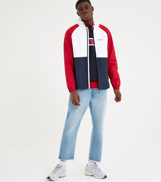 Ashton jacket in red, white and blue. Featuring full zip, hood with drawcords, hem with drawcord, contrasting colour panelling and printed logo.. Pair with an original tracksuit.  Details: Red, White and Blue Regular Fit 100% Polyester Printed logo #NICCE