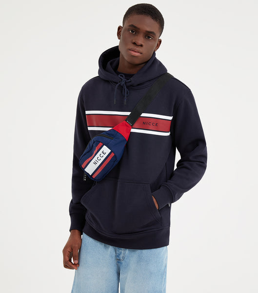 Varsity hood in navy. Featuring regular fit, overhead hood, front pouch, red and white chest stripe design and printed logo.