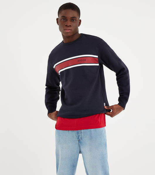 Varsity crew neck sweatshirt in navy. Featuring crew neck, long sleeves, printed stripe design in red and white with printed chest logo. Pair with joggers or denim.