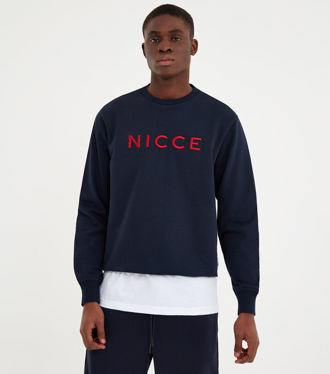 Lithium crew neck sweatshirt in navy. Features crew neck, long sleeves and embroidered logo. Pair with joggers or denim.