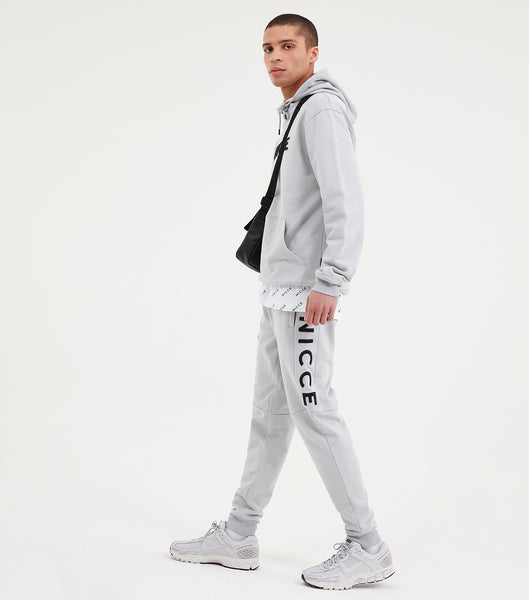 Lithium jogger in grey. Featuring elasticated waistband and cuffs, waist drawstrings, pockets, large printed leg logo. Pair with lithium hood.  Details:  Grey Regular fit Drawstring waist  100% cotton NICCE original logo  #NICCE