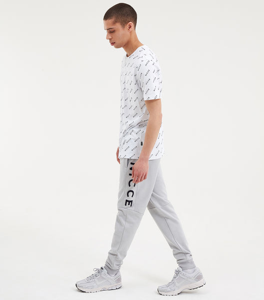 Repeat short sleeve t-shirt in white. Featuring crew neck, short sleeve and printed repeat logo. Pair with joggers or shorts.