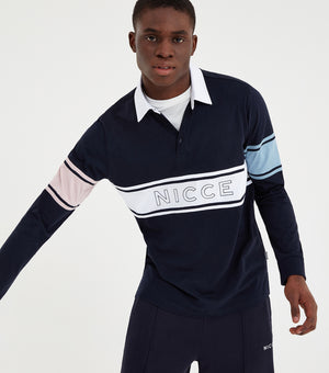 Rugby long sleeve shirt in navy. Featuring classic rugby shirt shaping, contrast colour arm stripes in blue and pink, chest nicce logo, collar and long sleeves. Pair with joggers or shorts.
