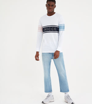 Panel long sleeve t-shirt in white. Featuring contrast stripe design, printed nicce chest logo, contrasting arm stripes in pink and blue and navy chest stripe. Pair with joggers or shorts.