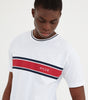 Varsity t-shirt in white. Featuring printed varsity stripe in navy and white, contrasting navy crew neck rib, short sleeves and printed logo. Pair with joggers or shorts.