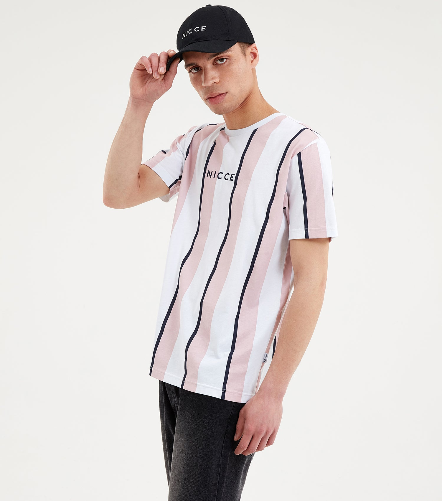 Stripe t-shirt in white, pink and navy. Featuring vertical stripe design in pink and navy, crew neck, short sleeves and printed centre logo. Pair with shorts or joggers.