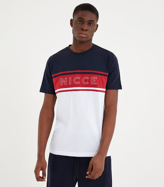 Panel short sleeve t-shirt in navy, red and white. Featuring crew neck, short sleeves, color block design with red stripe and white printed chest logo. Pair with shorts or joggers.