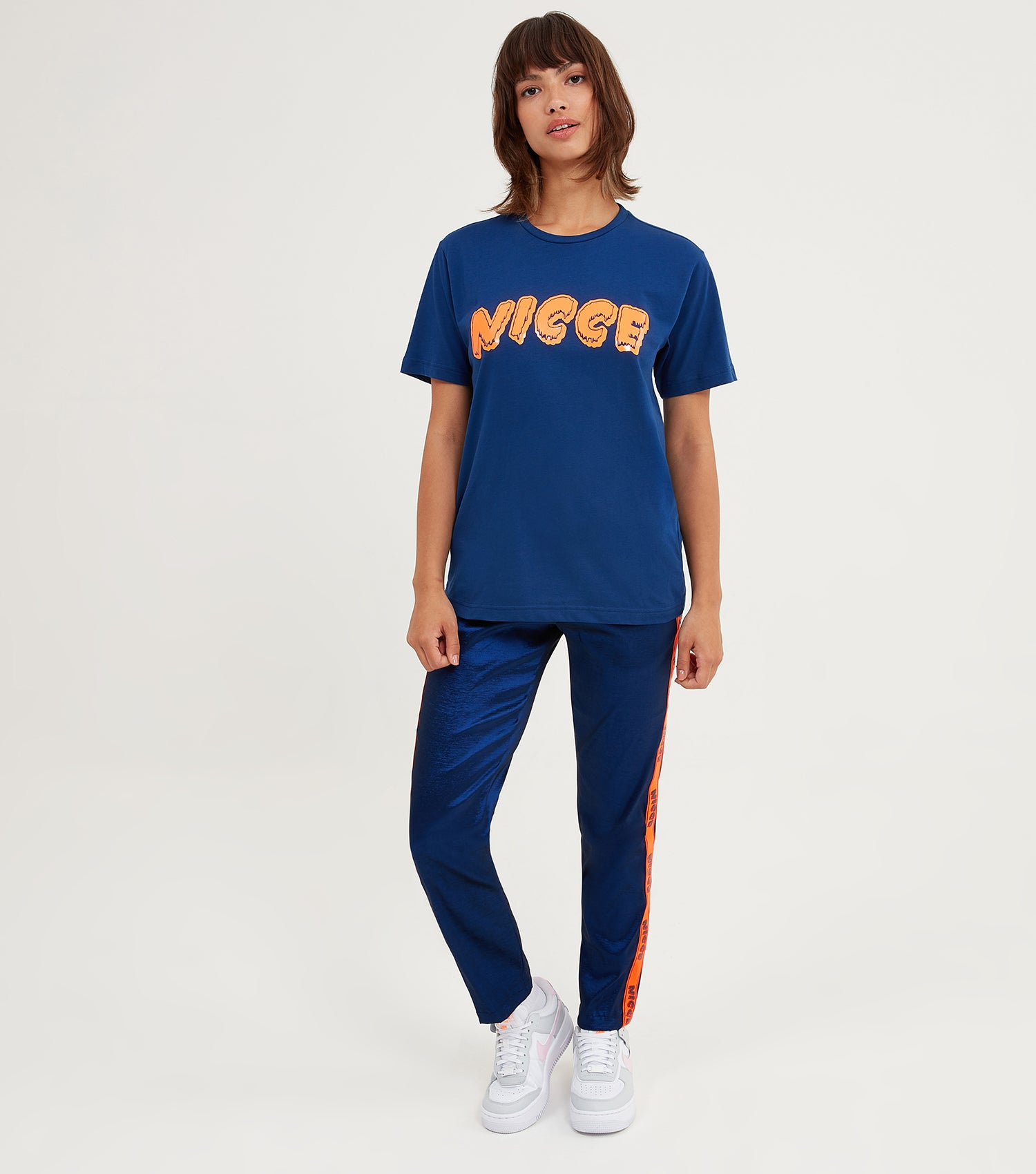 NICCE Womens Fete T-Shirt | Blue Depths/ Fiery Coral