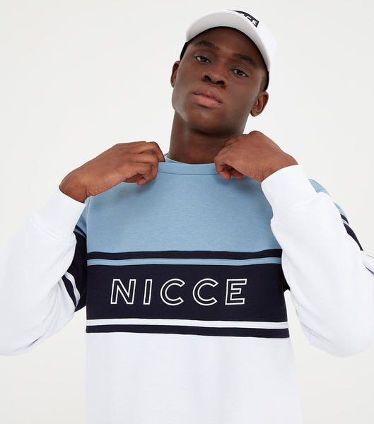Panel crew neck sweatshirt in blue. Featuring crew neck, long sleeves, colour block design with navy chest stripe and printed logo. Pair with joggers or denim.