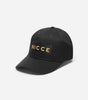 NICCE adey cap in black. Features gold embroidered logo, internal branding and debs clasp.