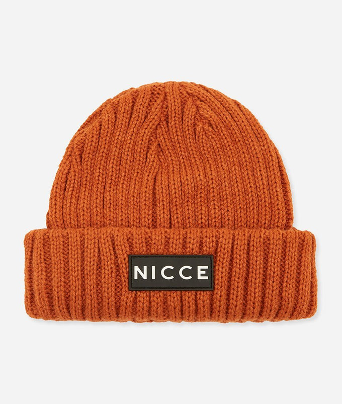 Burnt Orange knitted beanie with fold over brim and applique NICCE label. A Winter essential to get you through the season.