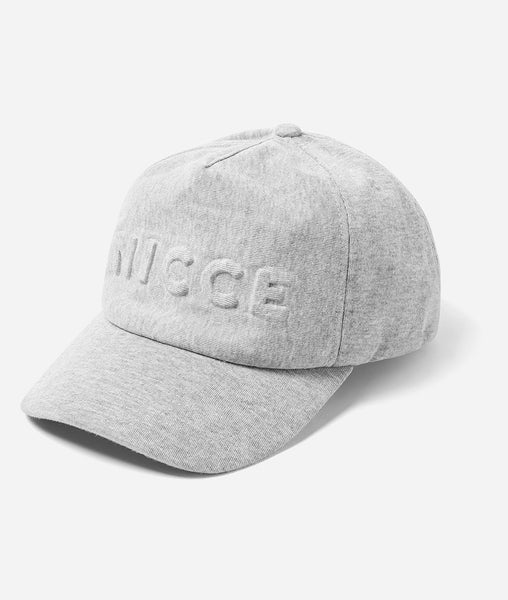 600d curve peak core cap, metal branded fastening with NICCE embsed branding & repeated logo lining.