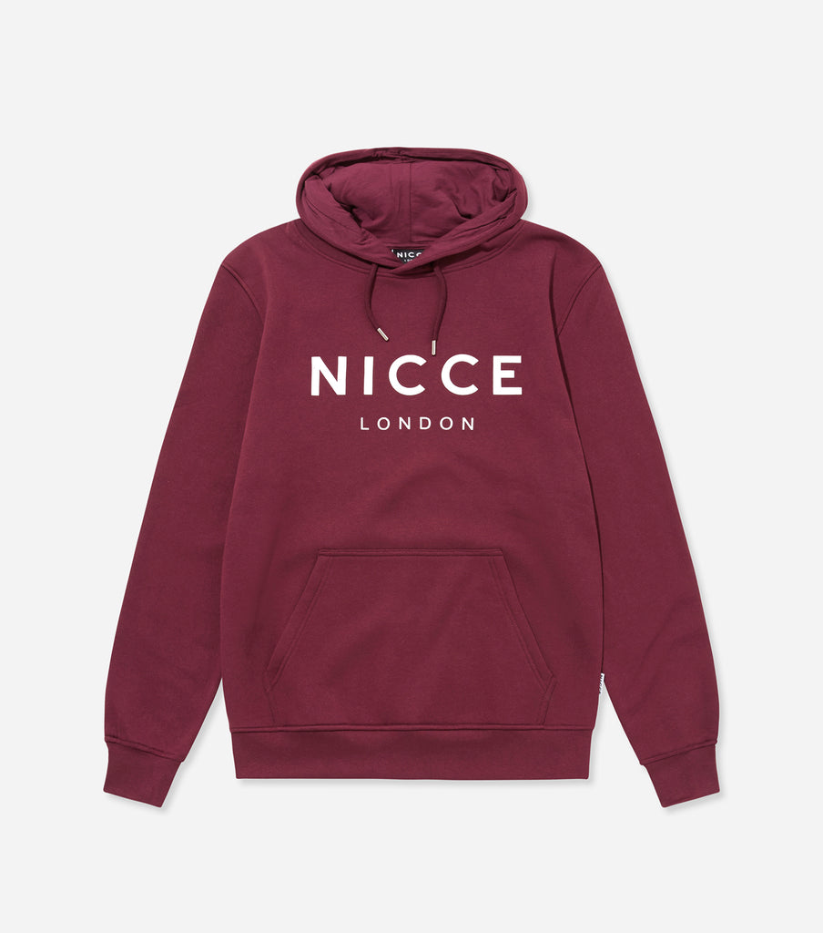 This burgundy hoodie features the NICCE logo on the chest. A pullover hoodie with an overhead hood style with drawstrings, pouch pocket and an oversized, comfortable fit.