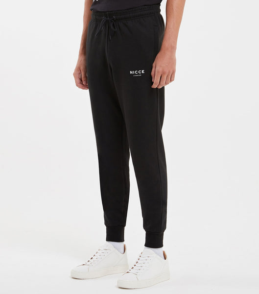 Black joggers made from soft cotton mix featuring the NICCE logo on the left leg. A tapered fit, it has an elasticated waist with drawcord, side pockets and ankle cuffs. Wear with matching hood.