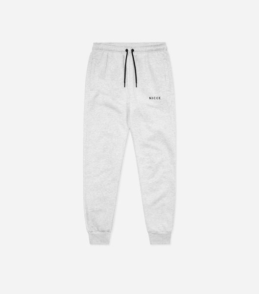 Grey joggers made from soft cotton mix featuring the NICCE logo on the left leg. A tapered fit, it has an elasticated waist with drawcord, side pockets and ankle cuffs. Wear with matching hood.