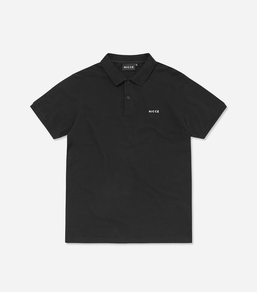 Core polo shirt in black. Features classic pique fabric, button up front, flat knit collar, short sleeves with printed chest logo. Pair with denim.