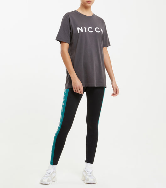 This coal top features the large classic NICCE London logo across the chest. A short-sleeved t-shirt is a style staple for any wardrobe and can be paired with jeans or joggers for casual comfort.