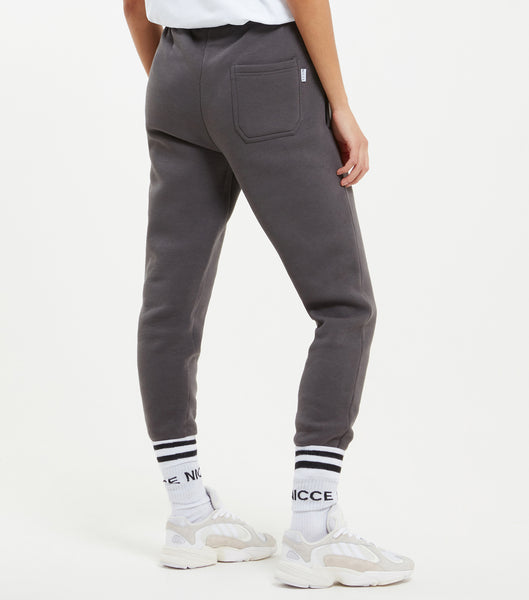 NICCE original Joggers in coal. Features relaxed tapered fit, small printed logo, angled front pockets, branded eyelet and cord ends and elasticated cuffed hem with back patch pocket with small woven side tab label. Pair with matching hood.