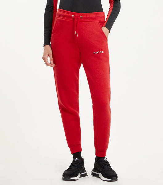 NICCE original Joggers in red. Features relaxed tapered fit, small printed logo, angled front pockets, branded eyelet and cord ends and elasticated cuffed hem with back patch pocket with small woven side tab label. Pair with matching hood.
