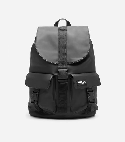 Carni drawstring backpack in black. Features drawstring, front flap, badge branding, two front pockets, two padded straps and a handheld strap.