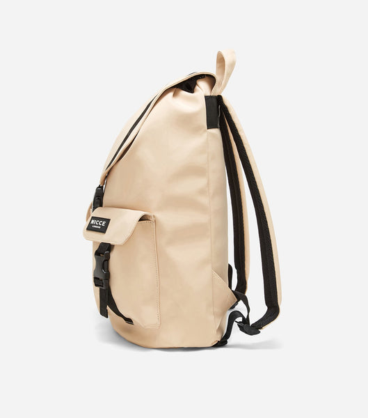 Hervi drawstring backpack in stone. Features drawstring, front flap, badge branding, two front pockets, two padded straps and a handheld strap.