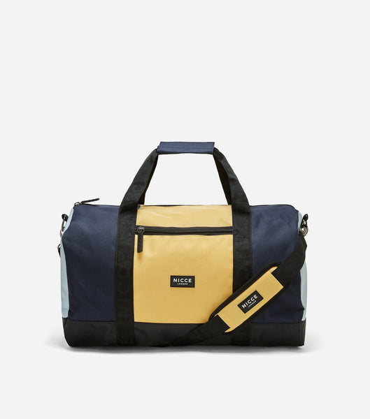 Yellow and navy barrel bag featuring a front zipped pocket, NICCE woven logo, repeated logo lining, grab handle and detachable shoulder straps. Great for the weekend trips or the gym.