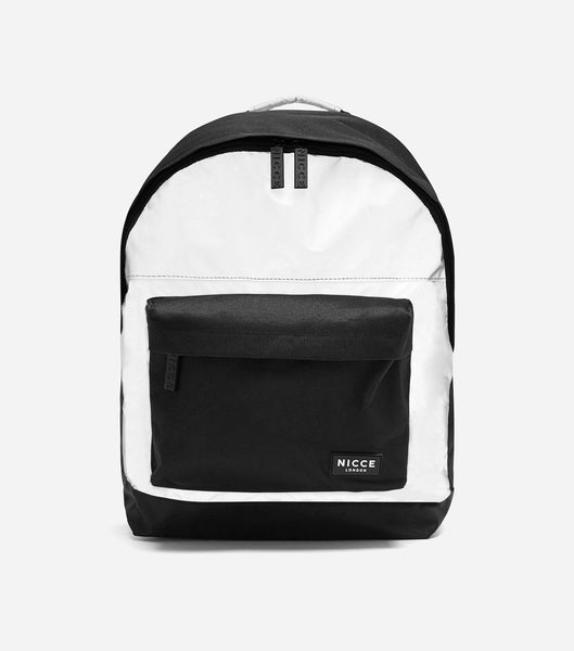 Reflective backpack featuring an external front zipped pocket, NICCE woven logo badge, repeated logo lining, padded adjustable straps, and a reinforced grab handle.