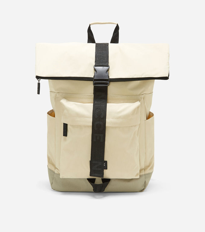 600D roll top backpack in stone featuring a front zipped pocket, NICCE woven in label, padded adjustable straps, and a roll top with zip and clasp closure.