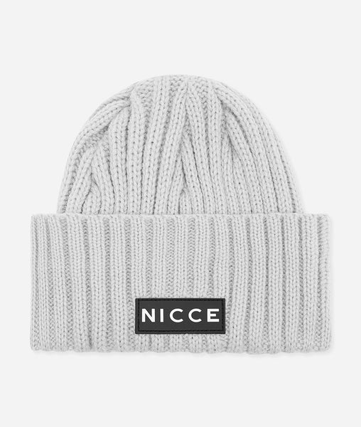Grey marl knitted beanie with fold over brim and applique NICCE label. A Winter essential to get you through the season.