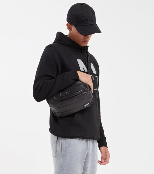 Designed for practicality and style this black bum bag featuring a front zipped pocket, quilted fabric, NICCE logo badge and an adjustable strap.