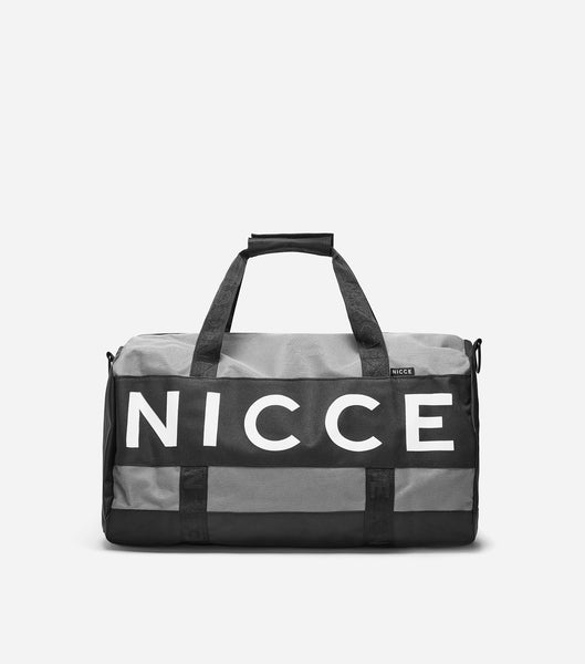 NICCE lany barrel bag in black. Features large printed logo, rubber logo on removable strap and branded lining.
