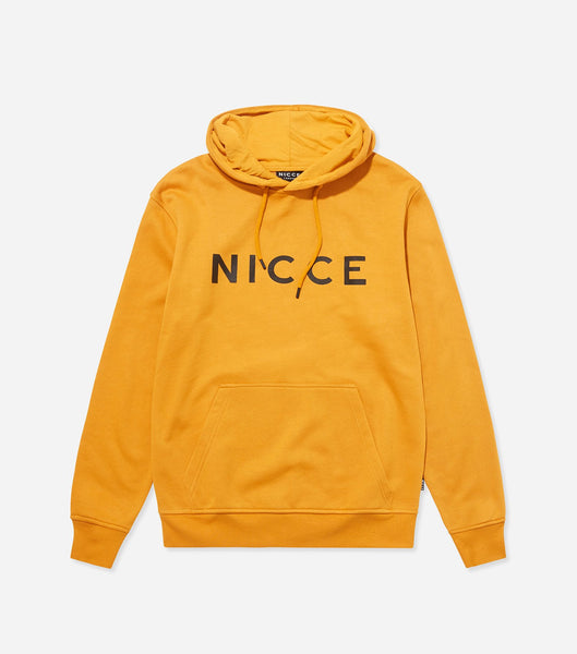 This golden yellow hoodie features the NICCE logo on the chest. A pullover hoodie with an overhead hood style with drawstrings, pouch pocket and an oversized, comfortable fit. Pair with matching joggers.