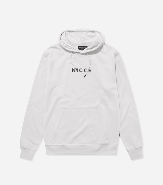 This cloud grey hoodie features the NICCE logo on the chest. A pullover hoodie with an overhead hood style with drawstrings, pouch pocket and an oversized, comfortable fit.