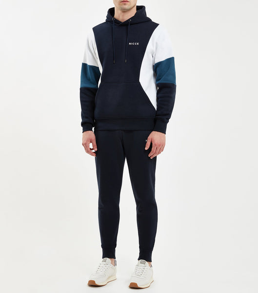 Union hood in navy. Features multi-colour panelling in Majorca blue, navy and white, hood, printed logo, elasticated cuffs and waistband. Pair with joggers.