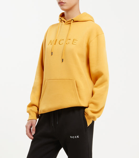 Mercury overhead hood in yellow. Features raised embroidered tonal chest logo, hood drawstrings, ribbed cuffs and waistband. Pair with joggers.
