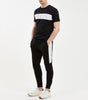 Colt jogger in black. Features skinny fit, large printed logo branding on the leg, two colour panelling in black and white with elasticated waistband and drawcords. Pair with hood.