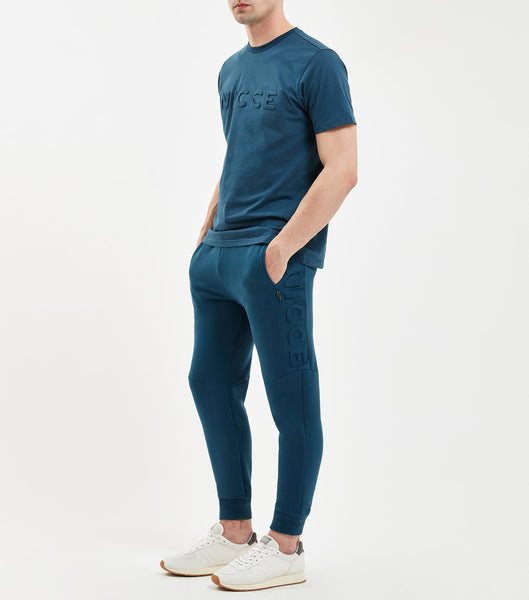 Emboss jogger in majorca blue. Features skinny fit, embossed logo leg panneling, elasticated waitband and drawcord. Pair with Emboss Hood.