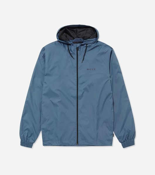 Windbreaker in majorca blue. Features full zip, hood with drawcords, elasticated cuffs, small chest branding and two side pockets. Pair with joggers.