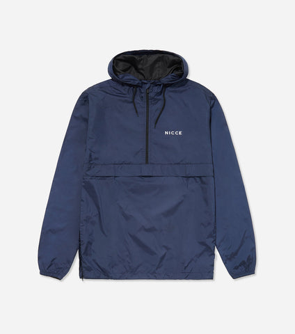 Core cagoule in deep navy. Features light weight material, overhead hood, chest branding, two side entry pockets. Pair with joggers.