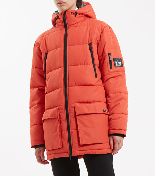 Fino parka jacket in orange. Features quilted fabric, full zip, hood, four front pockets, arm pocket,contrast lining and arm badge branding.