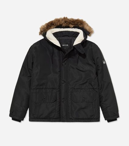 Stamford parka jacket in black. Features short length design, button and zip enclosure, quilted design, hood with detachable faux fur trim, two front pockets and rubberised left arm branding. Pair with denim.