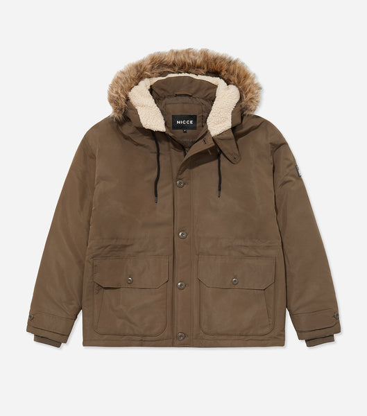 Stamford parka jacket in olive. Features short length design, button and zip enclosure, quilted design, hood with detachable faux fur trim, two front pockets and rubberised left arm branding. Pair with denim.