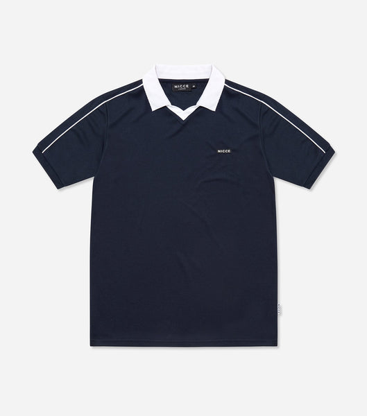 Team polo in deep navy. Features open neck, contrasting collar, rubberised chest badge branding, short sleeves. Pair with denim.